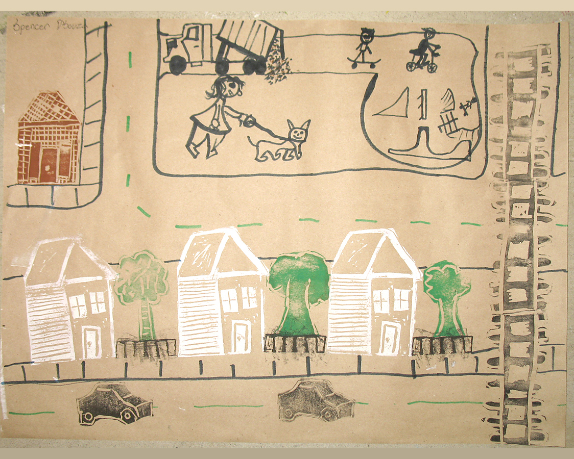 Primary age students created several lino-block stamps.  They used their stamps, magic markers and the stamps of others, to create pictures of imagined cities.